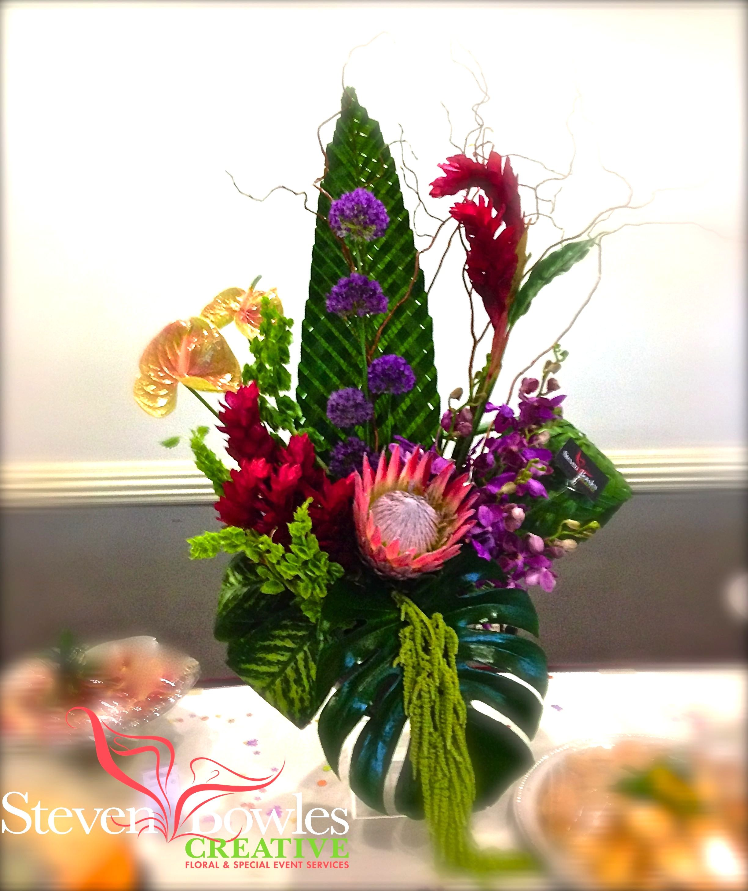 Tropical Flower Arrangement Large Tropical Arrangement Of Ginger King Protea Anthuriums Orchids And Woven Palm Fronds Designed By Steven Bowles Creative