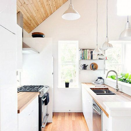 A small kitchen is no one's friend. But just like dark under-eye circles, wacky in-laws or your inability to hold a camera still, sometimes you just have to learn to deal. Here are seven solutions for your small-kitchen problems, whether you have a tragic amount of counter space or claustrophobic cabinets.