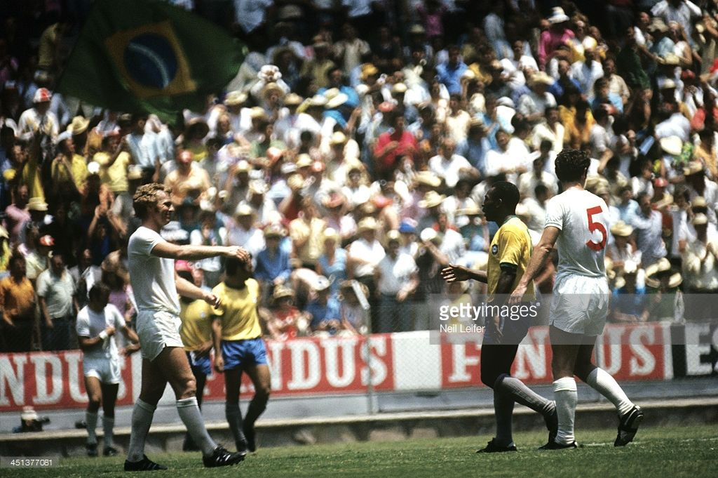 Brazil Pele speaks to England captain Bobby Moore after
