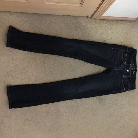 American Eagle Jeans Dark blue Skinny Kick American Eagle jeans! Hardly worn, not my size anymore. Really cool sequin logo on the back pockets, the perfect mix of skinny and flare jeans! American Eagle Outfitters Jeans
