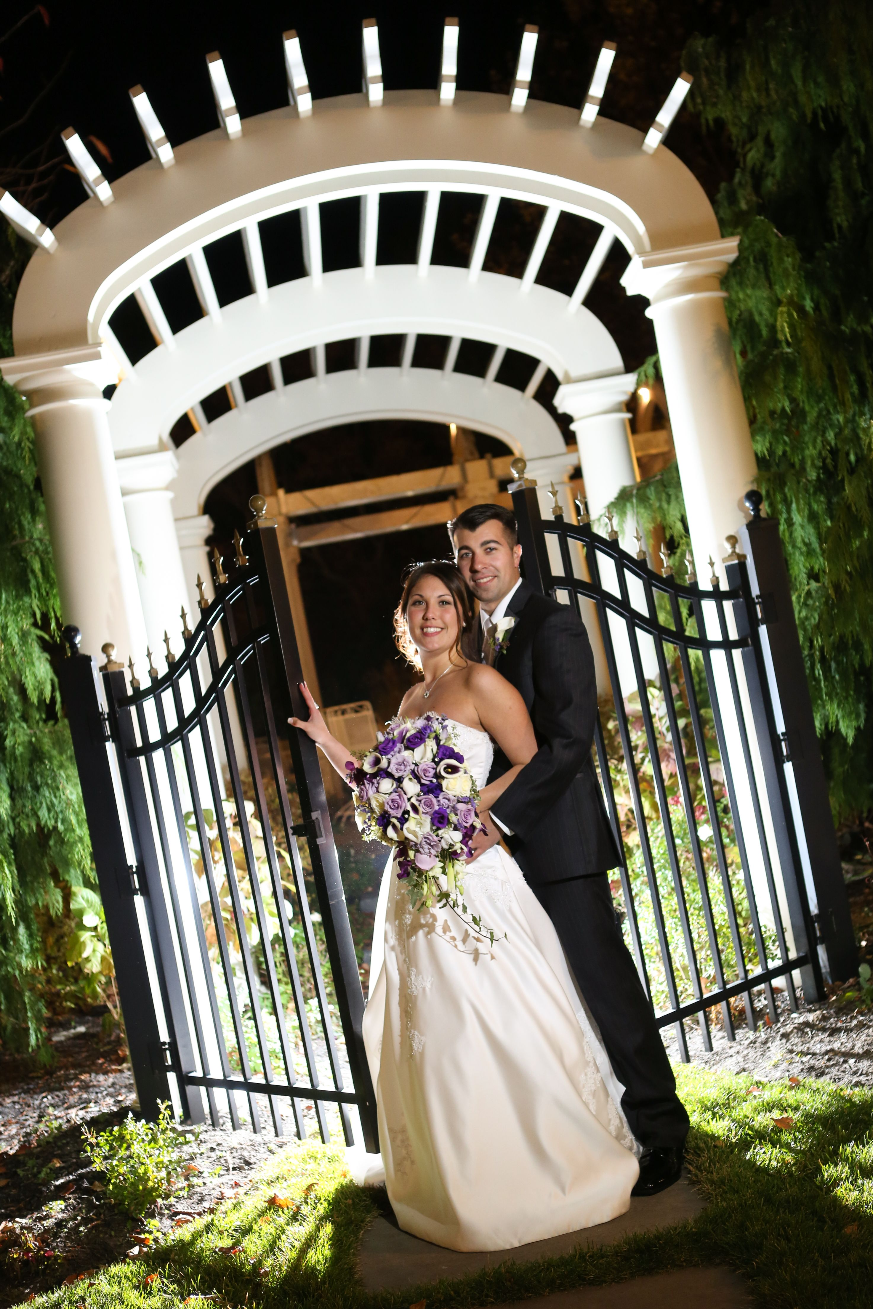bride and groom take pictures at nighttime at Giorgio's