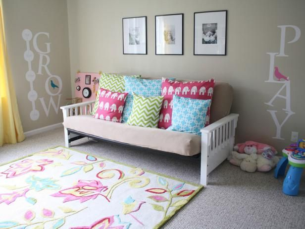 Futon in playroom can be used for a comfy place to read and a bed for guests.  I also like the vinyl on the walls.  Affordable Kids' Room Decorating Ideas : Rooms : Home & Garden Television