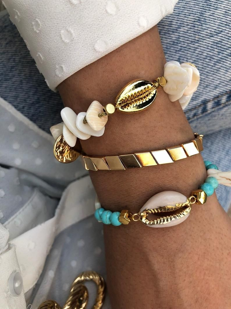 handmade shell bracelet with kauri shells in gold and sky blue