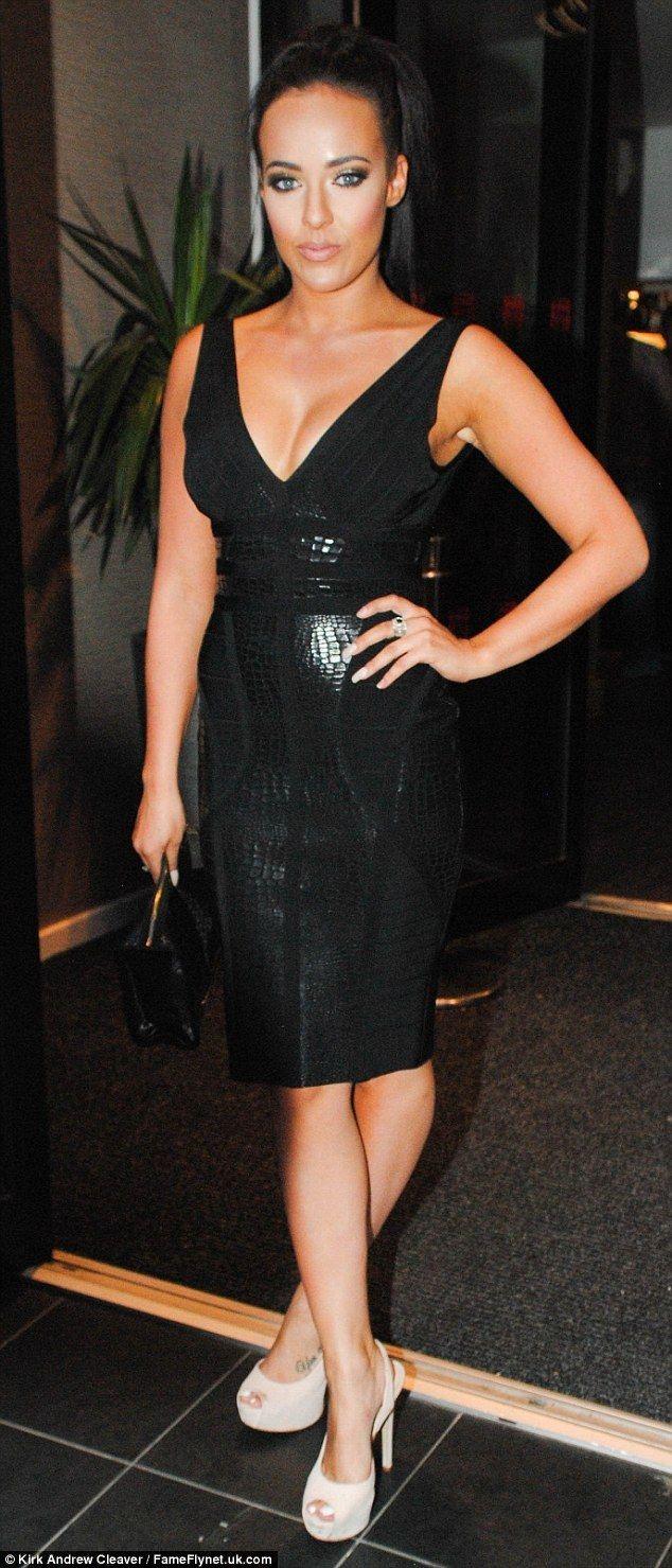 Little black dress: Stephanie showed off her assets in a plunging black skintight dress...