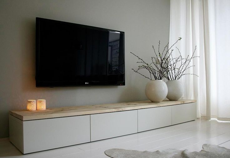 Short IKEA Besta unit on a floor but with wooden tabletop