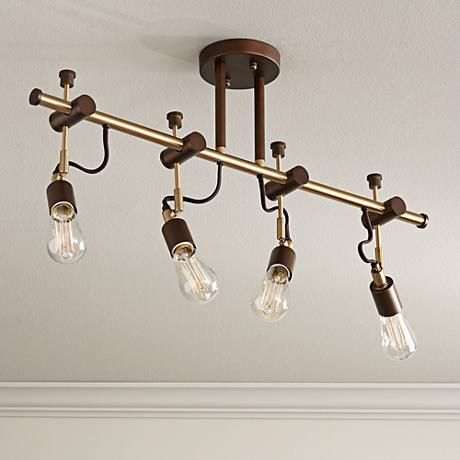 Antique Br Finish Accents Adds Sophistication To This Oil Rubbed Bronze Four Light Track Fixture Wide X High Without Bulbs 15 With