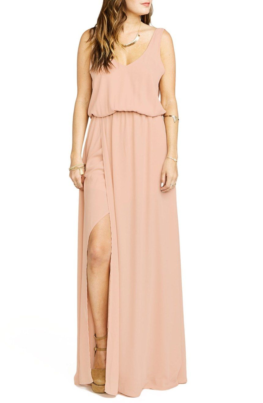 Draping beautifully off the body in fluid chiffon, this ultrafeminine gown features a V-neck bodice with a deep-cut back and a wraparound skirt ready to catch every breeze.
