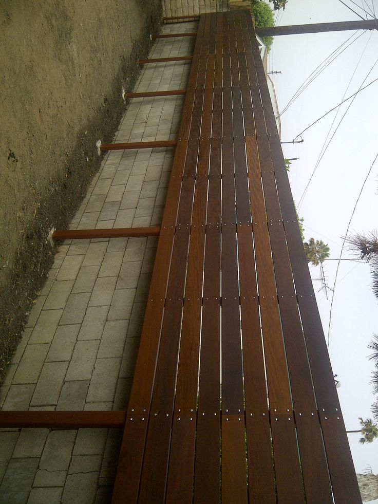 Horizontal Ipe Fence In Front Of Concrete Wall Cover Up