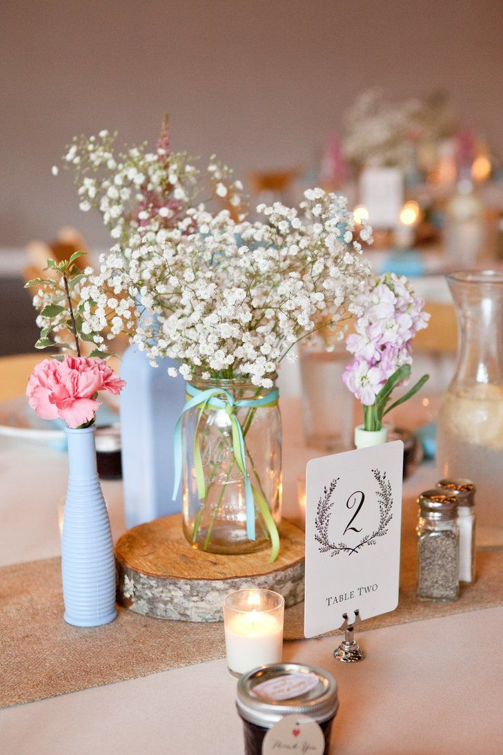 Country Style Centerpieces Were Full Of Baby S Breath Carnations And Stock Flowers Rustic Wedding Centerpieces Wedding Centerpieces Rustic Centerpieces Diy