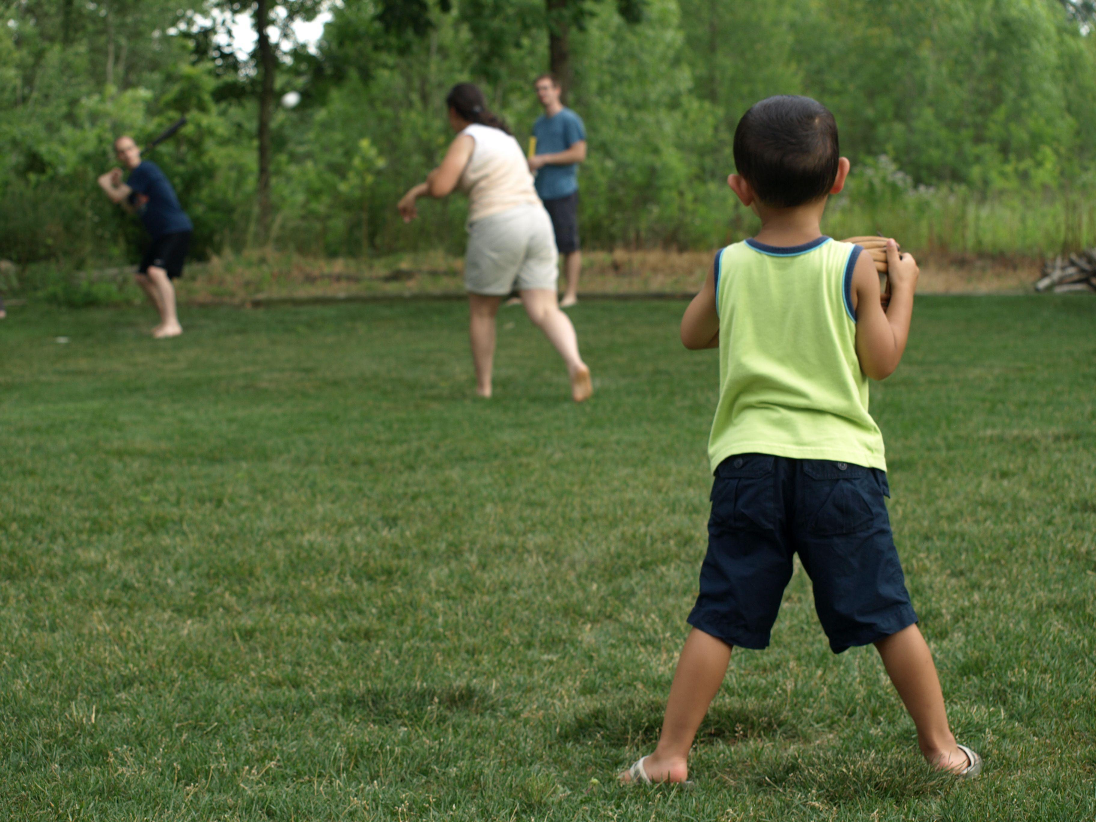 backyard baseball sports children playing family bbq picnic