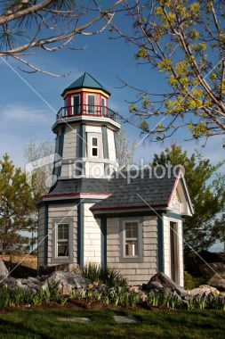 Garden Playhouse in the Fantasy Form of a Lighthouse Royalty Free Stock Photo