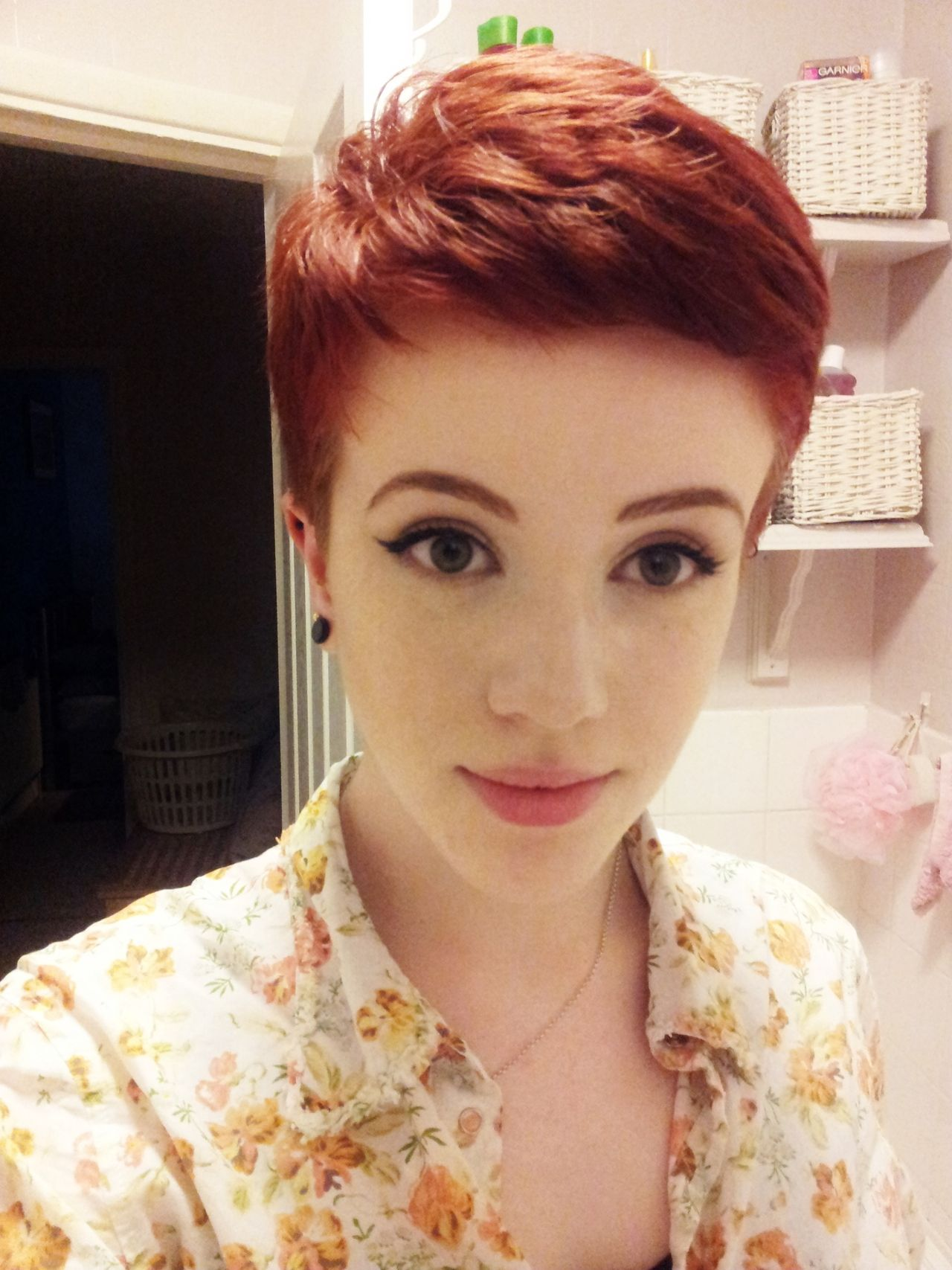 I love this cute pixie cut she has such a pretty red hair color too