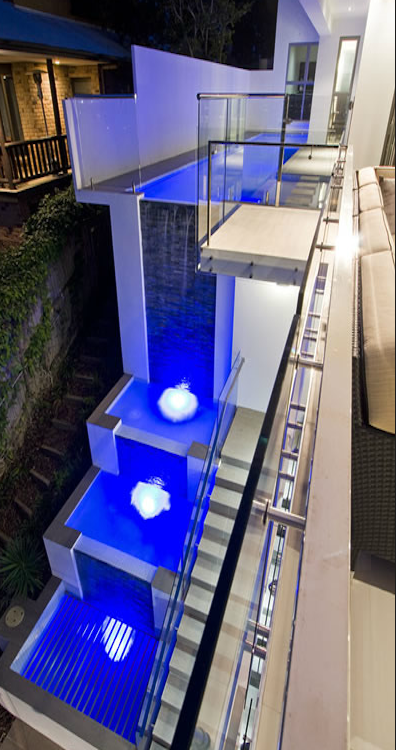 cool pool: fits as part of building structure as waterfall! where?! by which architect?
