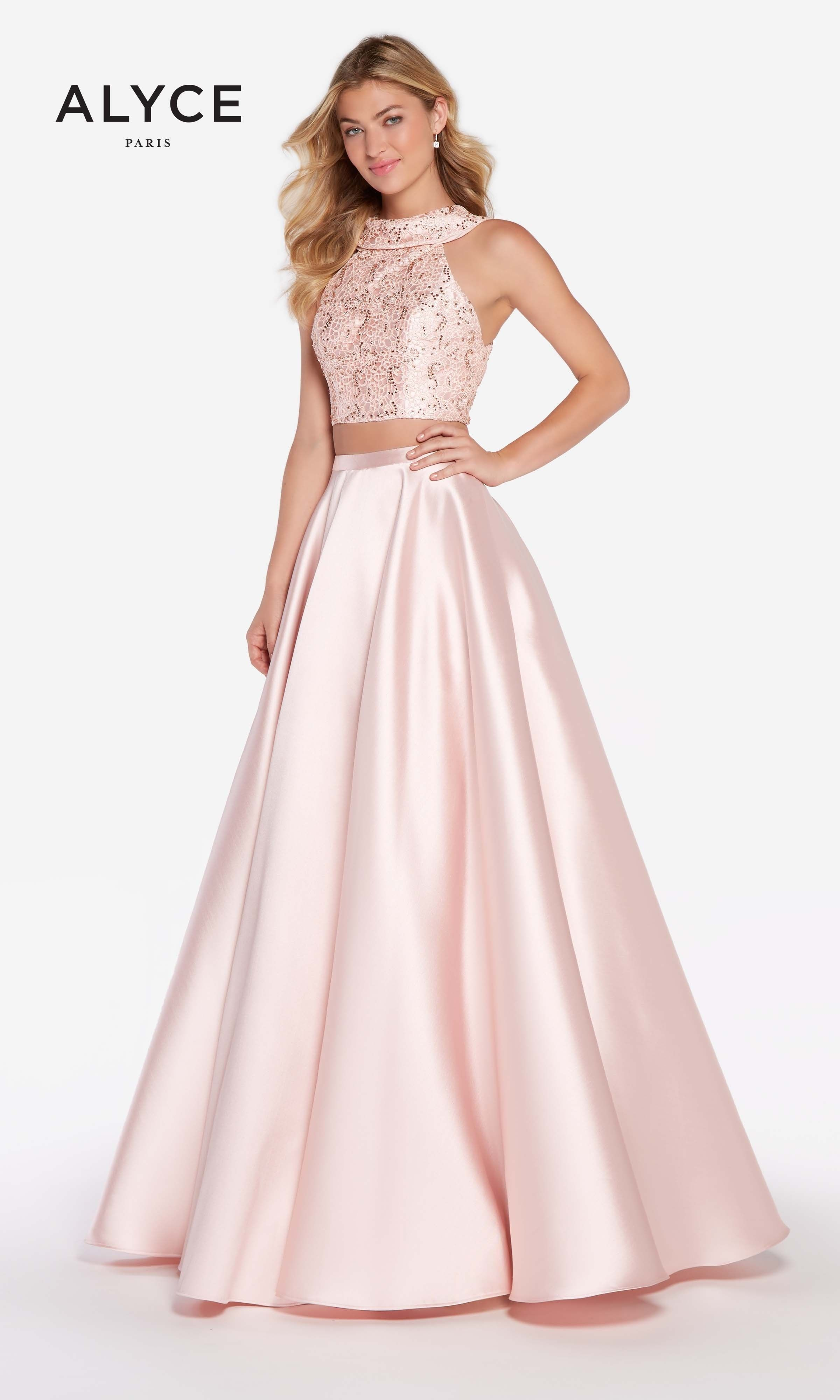89e1232de5ad54 This two piece ball gown features full shiny mikado skirt which sits right  at the natural waist. The matching lace crop top features a cowl ...