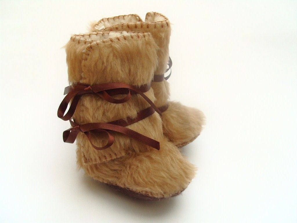 As seen on The Ultimate Baby Shower Gift by Cool by funkyshapes, $32.95 hey just cause she is little doesn't mean she can't have some fur boots!!