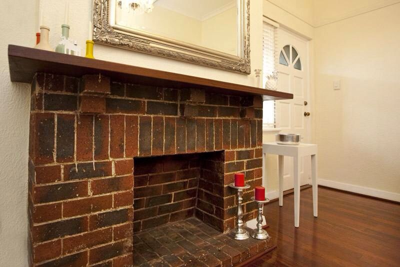 red brick fireplace in 1940s art deco apartment