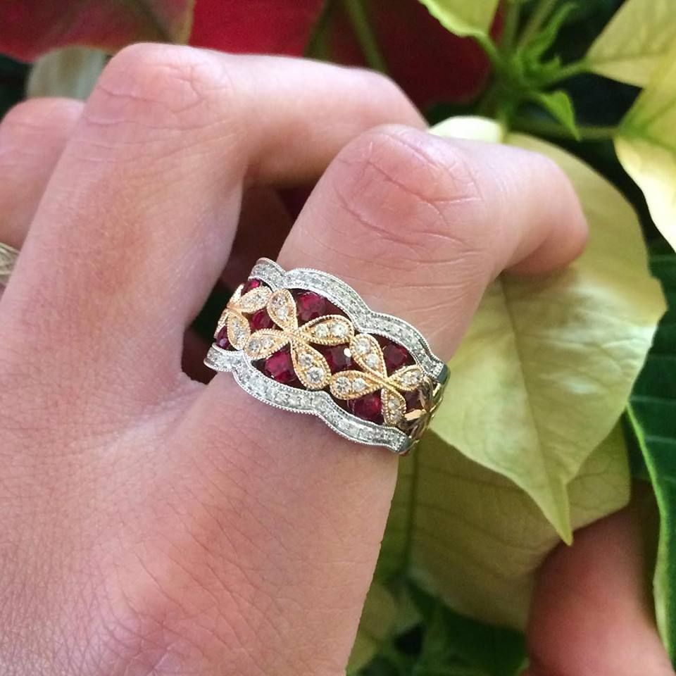 This bold statement ring set with .72 carats of rubies and just ...