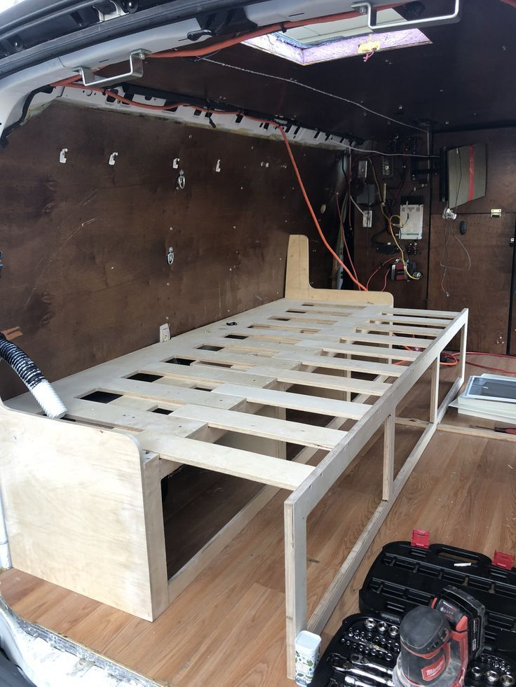 Custom Slide out couch/bed in a Chevy van. -