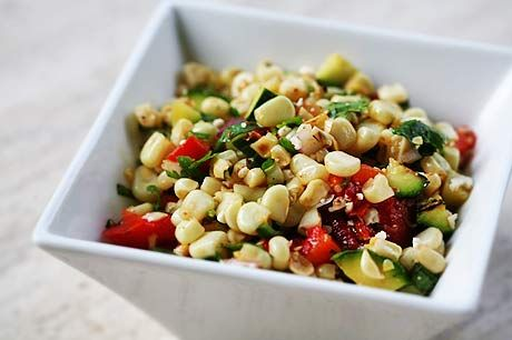Summery corn salad, made with grilled or toasted corn, zucchini, red bell pepper, red onions, cilantro, and seasoned with cumin, oil and vinegar.