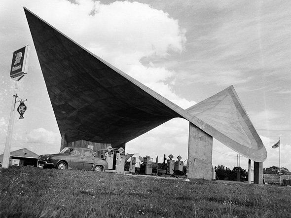 Pictured is a swooping roof design at a national service station in Retford, England, Sept. 22, 1961. Technically known as a hyperbolic derabold structure, the reinforced concrete roof weighs about 90 tons. There will be a motel, a restaurant and a repair section on the site when the station is completed. (AP Photo)