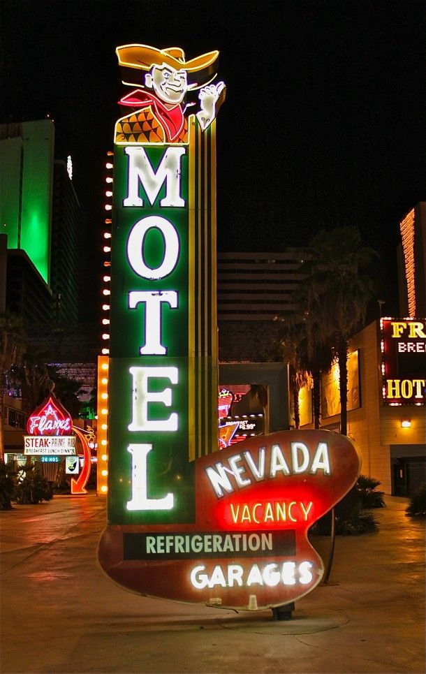 "Vintage Las Vegas neon - The Nevada Motel sign dates circa 1950. Its original location was 5t Street and Garces in Las Vegas.  An important feature is the first appearance of the image known as ""Vegas Vic"". It was restored by The Neon Museum and installed November 15, 2000."
