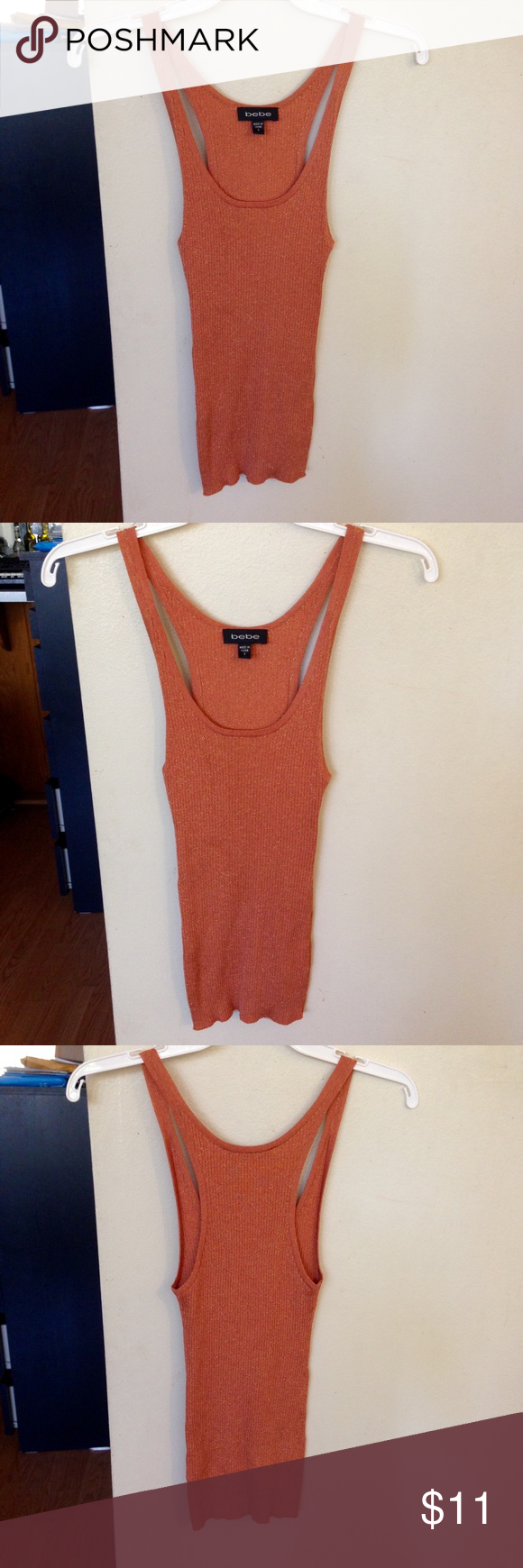 Bebe burnt orange glitter metallic tank top A cute Bebe burnt orange tank top in a size small. The material has shimmery metallic strands and is stretchy. Great for layering and for casual wear. bebe Tops Tank Tops