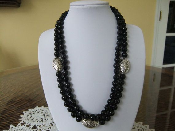 This is a lovely two strand black beaded necklace with silver filled oval beads. It is very simple, but stylish and can be worn to work, with blue