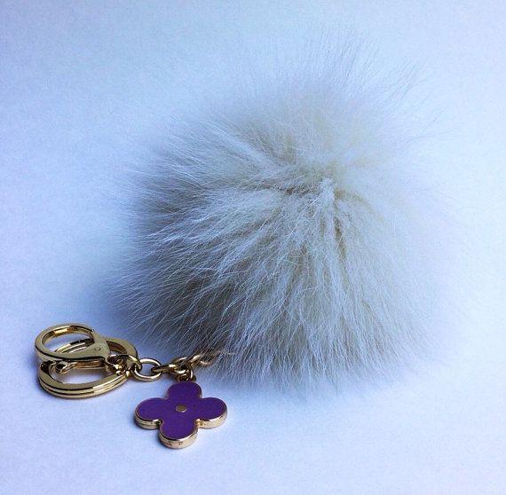Items similar to Off White Fur Pompon bag charm pendant Fur Pom Pom keychain  with flower charm on Etsy 8ce09c764
