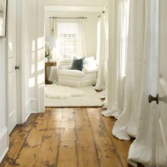 wood floor, white curtains, love how the curtains lay on the floor