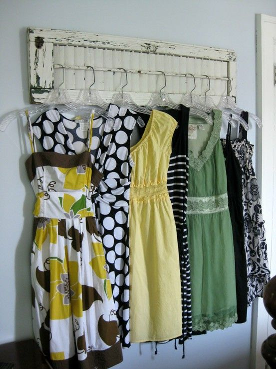 Small shutter repurposed into retail clothing store for Furniture to hang clothes