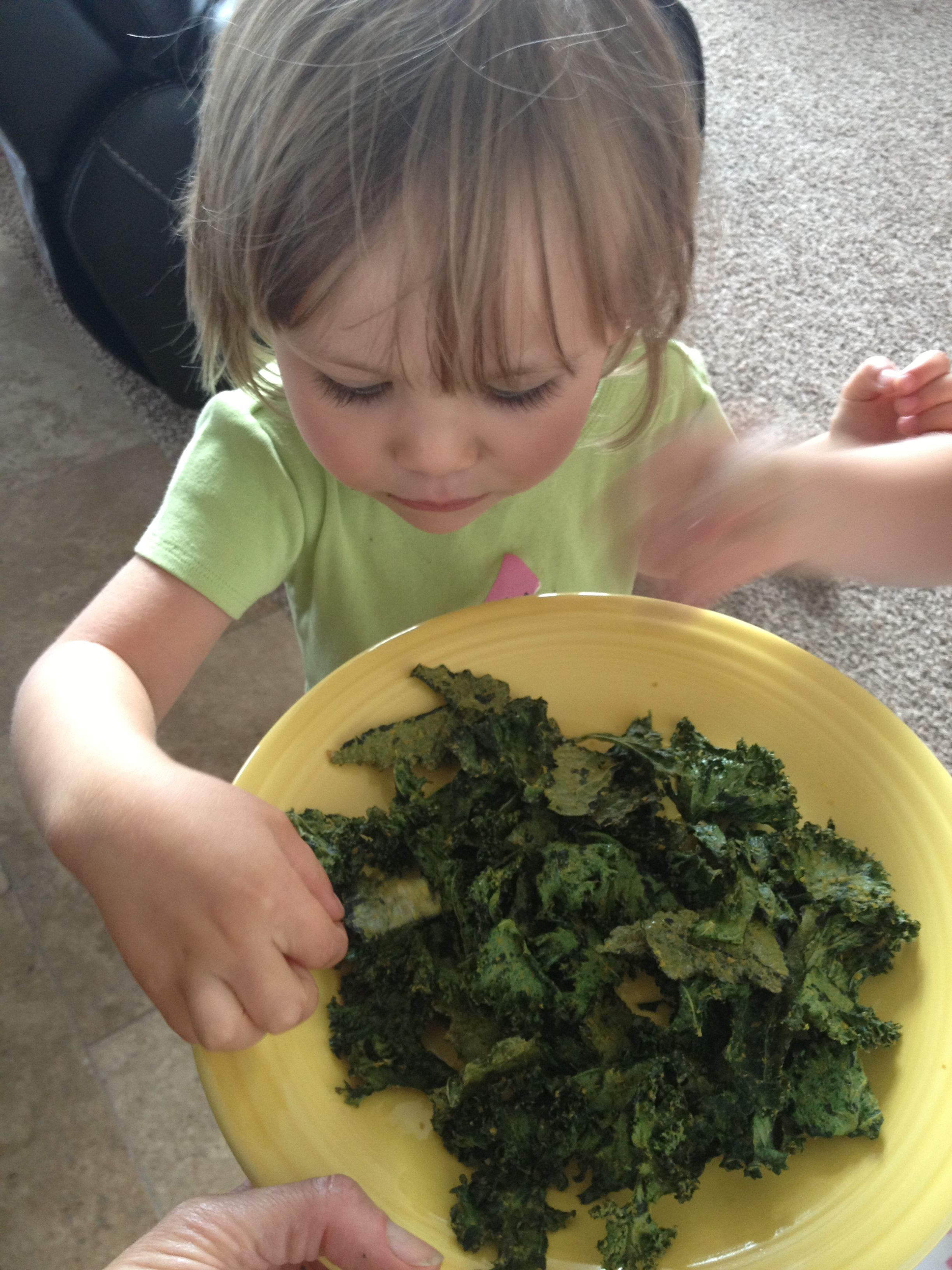 Roasted kale chips. From our garden. Check out the flurry of hands trying to grab them!