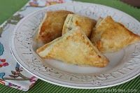 Chicken, bacon, sun dried tomato and cream cheese puff pastry triangles - great, easy app!