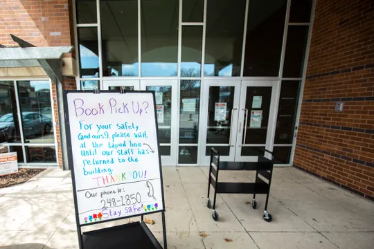 Librarians call for Coralville to cease curbside book