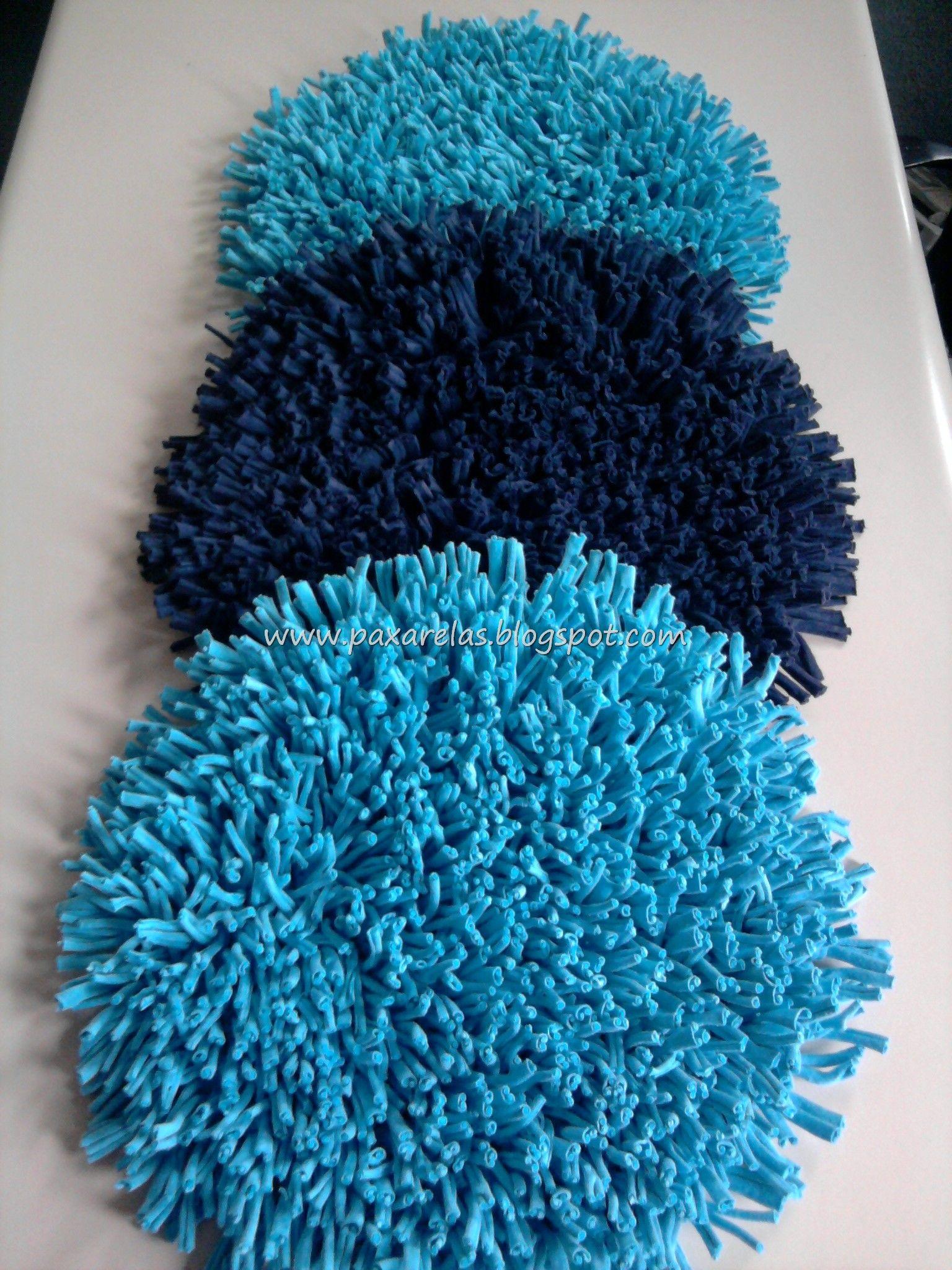 Tr o de alfombras circulares en turquesa y azul marino for Alfombra gris y turquesa