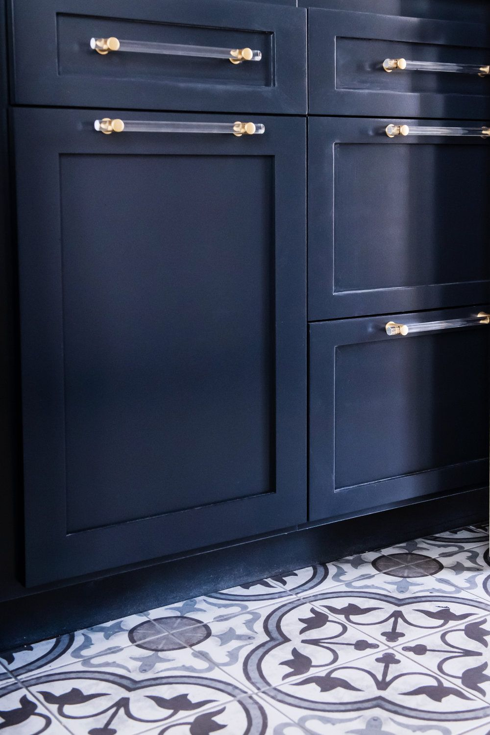 deep navy blue cabinets and pattern tile modern laundry