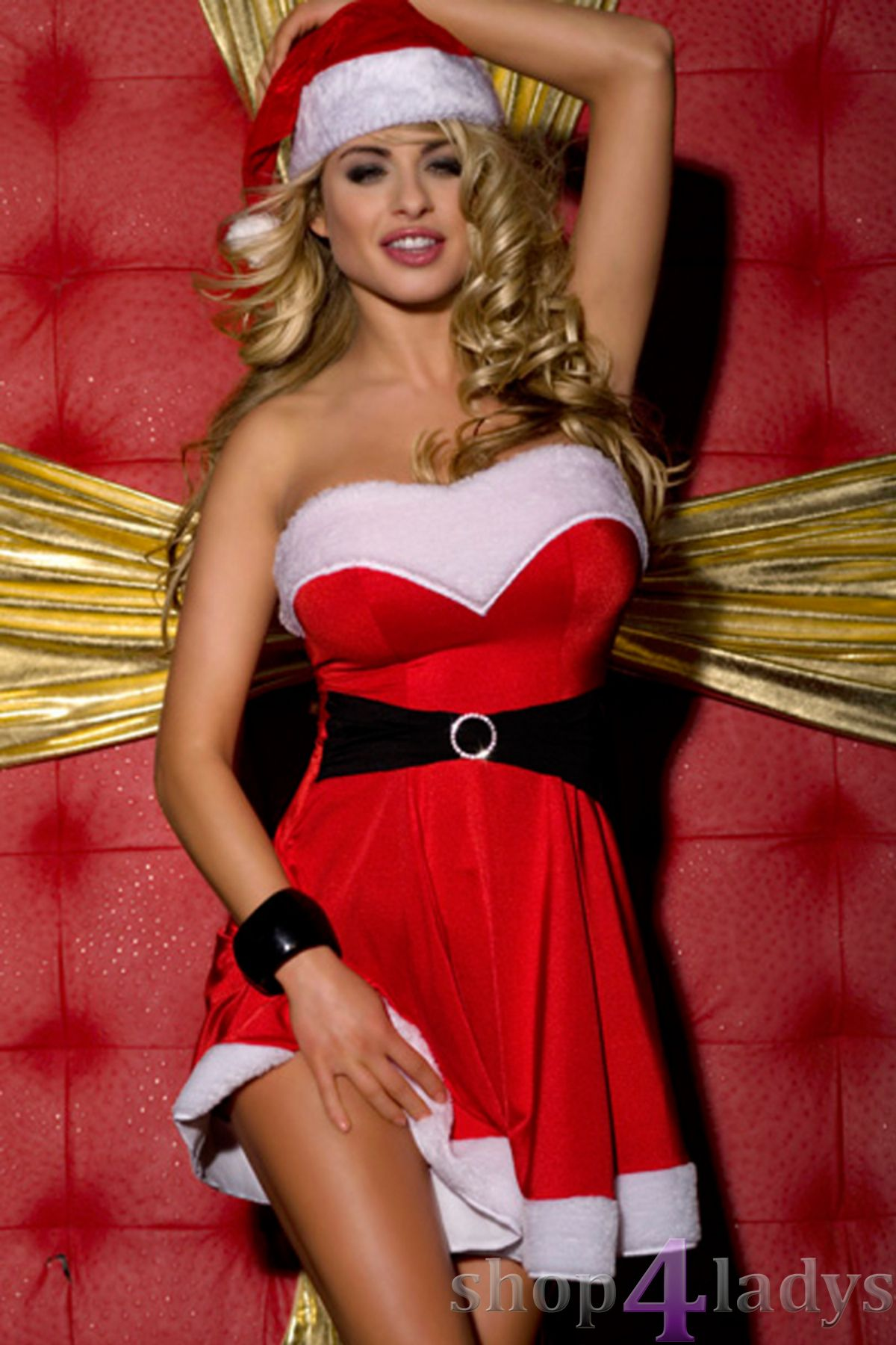Sexy mrs santa claus holding heavy stack of christmas gifts stock photo