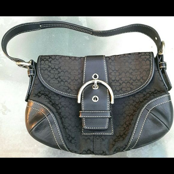 9b12e431bcd Coach sig jacquard  leather purse Black jacquard fabric with small signature  Cs. Black leather at corners, trim and handle. In excellent condition.