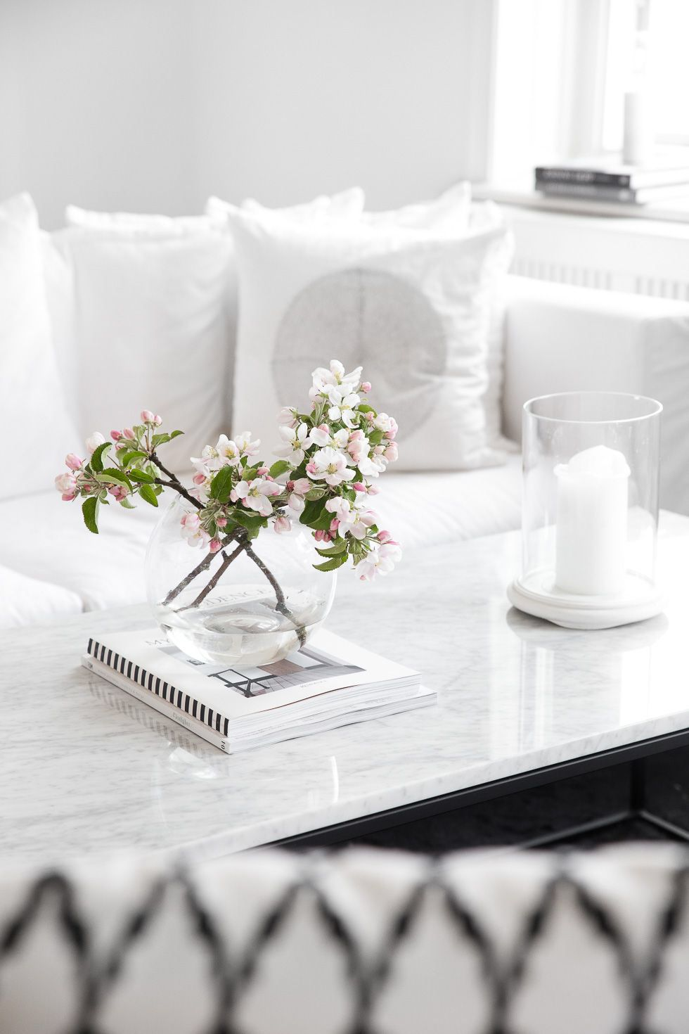 Apple Blossom adds a magical feeling in this all white room