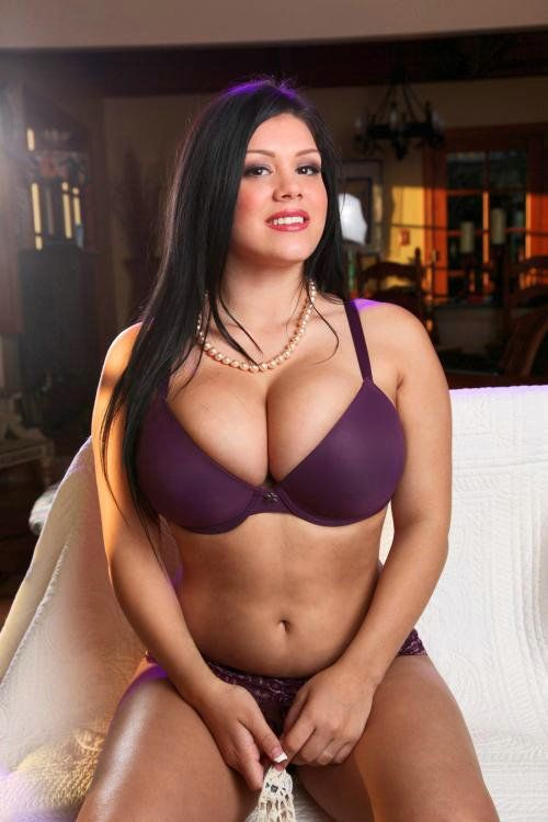 Busty And Beautiful in a bra with huge breasts.