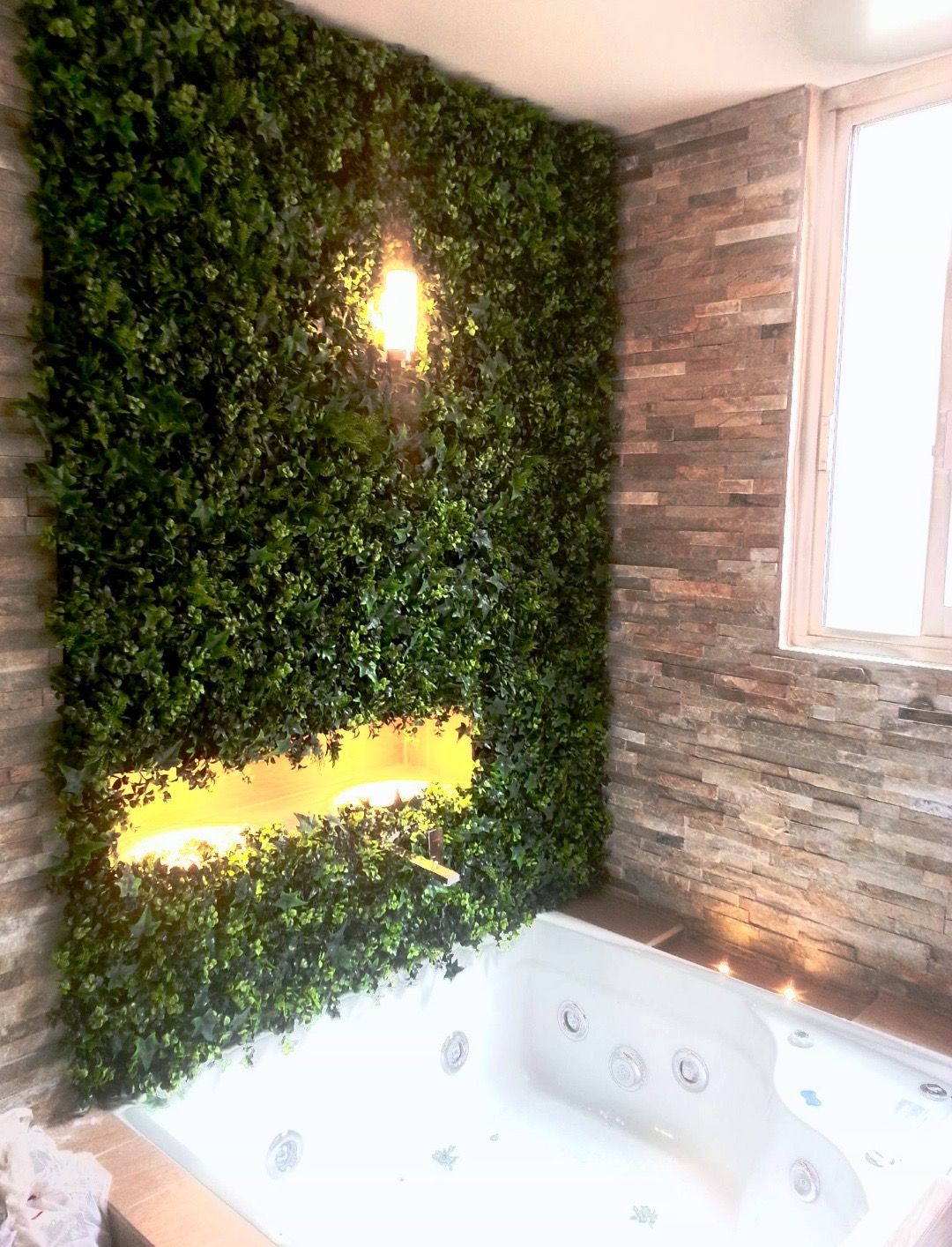 bathroom design with stone walls and artificial hedge
