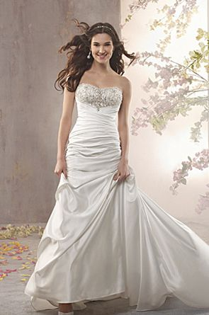 A classic gown of flowing satin with a ruched bodice. The shaped neckline features an array of delicate silver embroidery and dazzling bead work to complete your magical day.