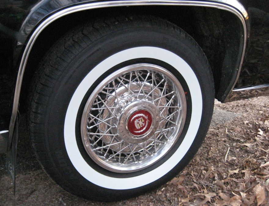Classic Wide Band White Wall On A Cadillac Hubcaps And
