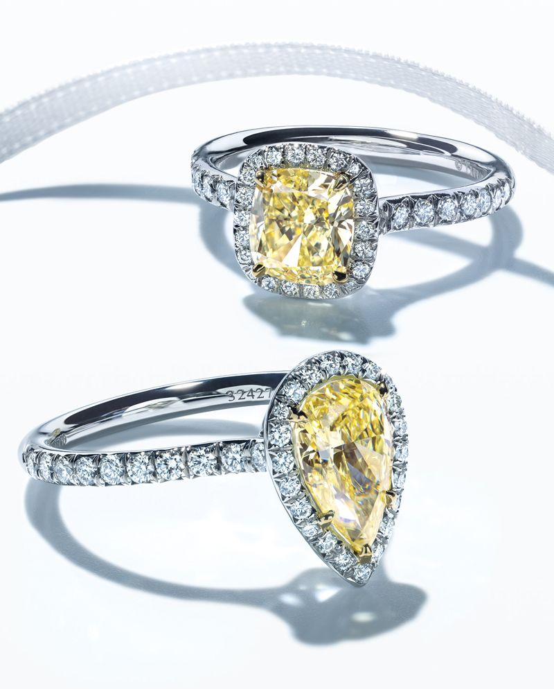 As radiant as the sun. Renowned the world over, Tiffany Yellow Diamonds capture the warmth and splendor of sunlight itself. Shown: Tiffany Soleste® engagement rings with yellow diamonds.