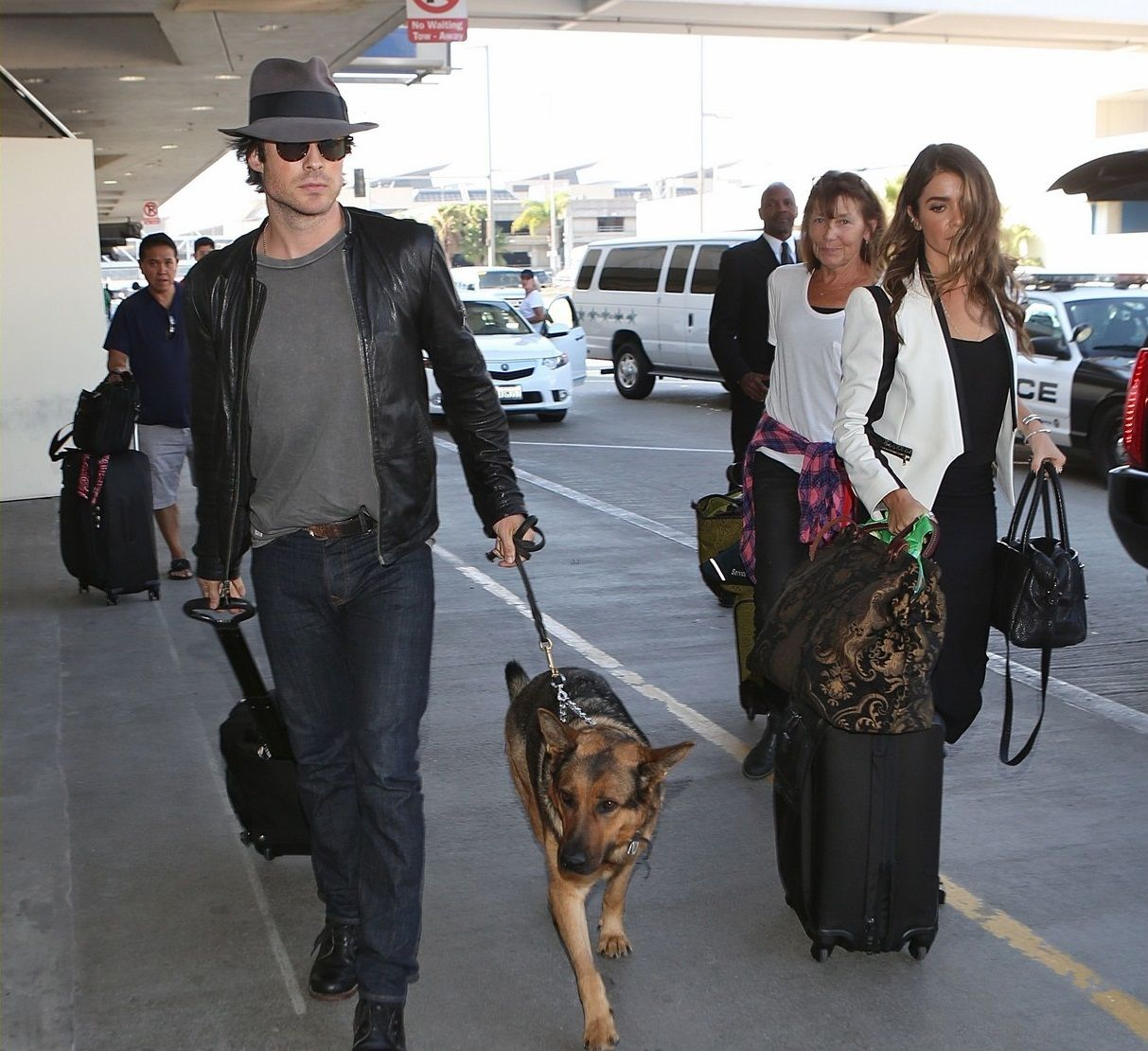 Ian Somerhalder and Nikki Reed check in for their Delta flight together on Friday afternoon (October 10) at LAX Airport in Los Angeles.