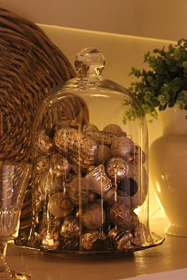 Simple vintage mercury glass ornaments under a cloche.