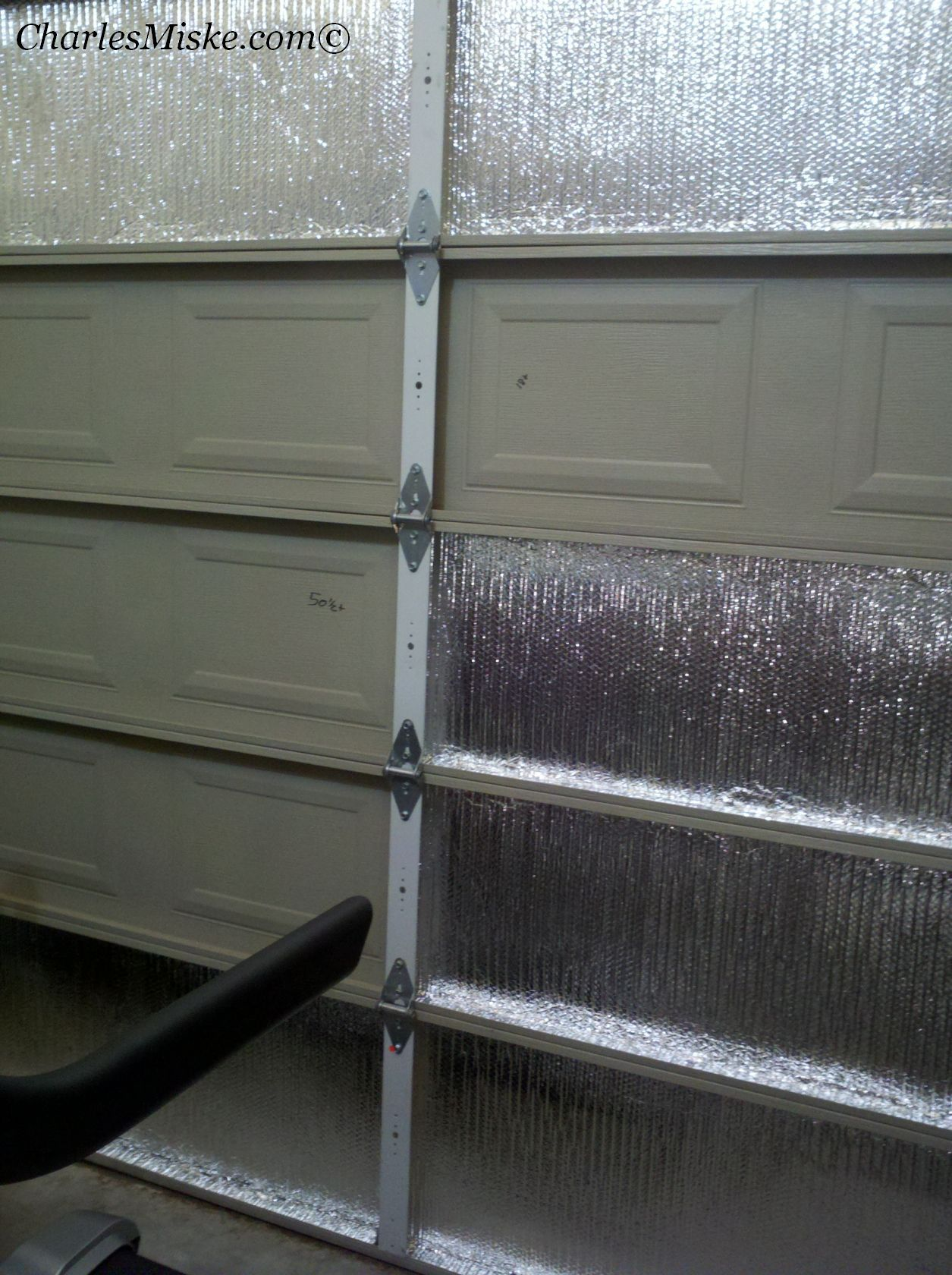 Insulate a garage door genius since my woodworking stuff is out
