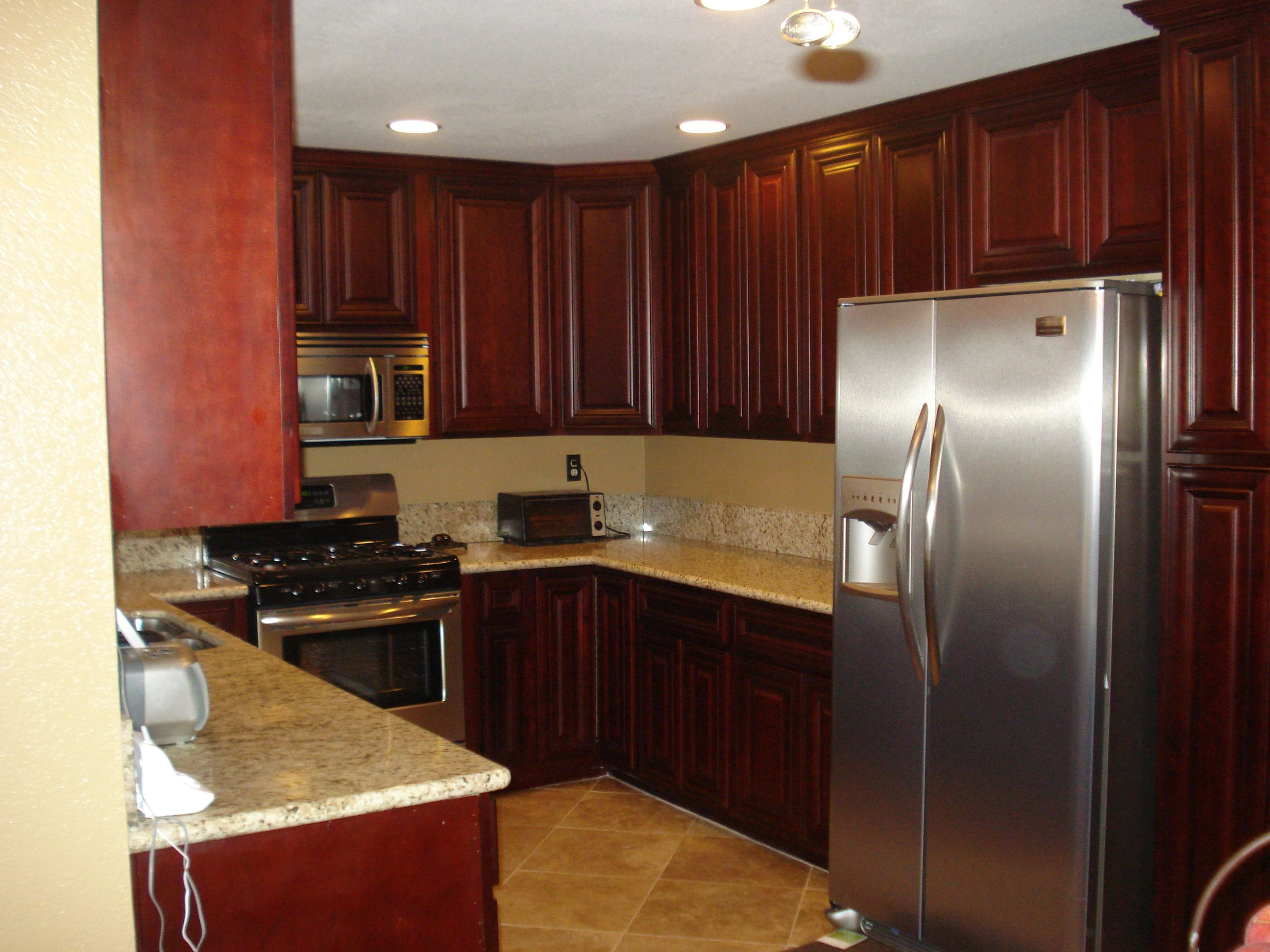 Magnificent White Marble Countertops In U Shaped Kitchen Cherry Red Veneer Cabinets As Inspiring Guest
