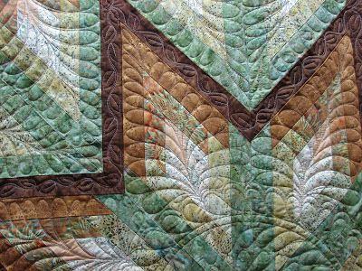 I got finished quilting Kathy's quilt in plenty of time for Christmas.   I am not sure what the pattern is, but I would consider it a take ...