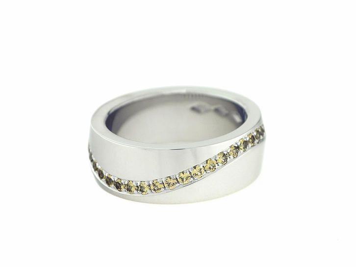 Saarikorpi Design, wedding ring with yellow saphires