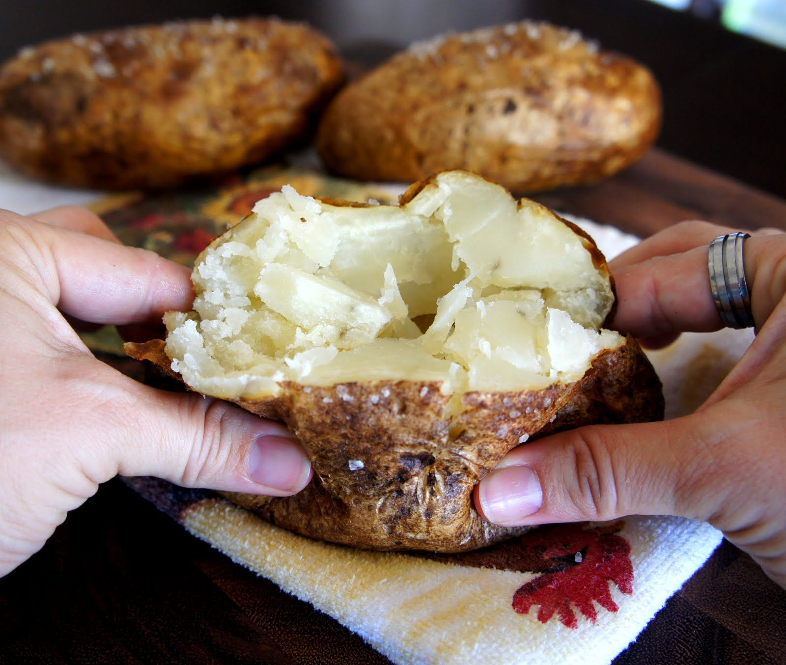 There are several methods to baking a potato, but this is my favorite because the potato skin is crispy and salty and the insides are soft and fluffy.